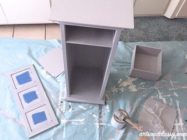 Disassebled painting small table cabinet with polka dots and gem door knobs gets painted with annie sloan chalk paint paris gray for DIY Furniture projects
