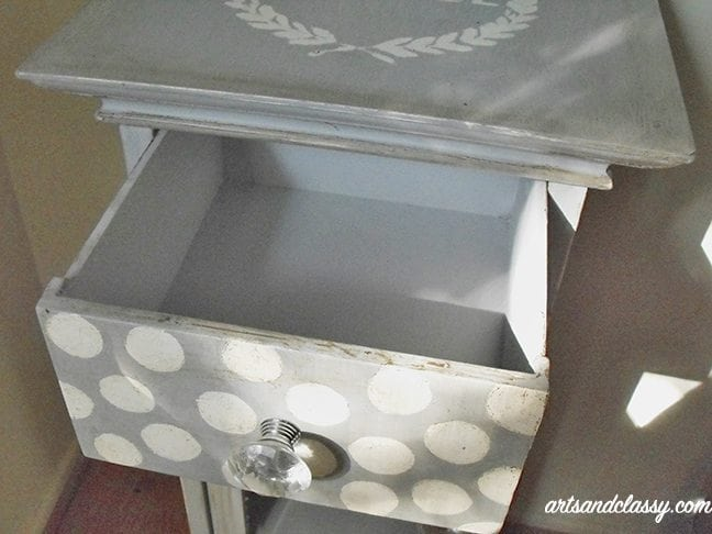 Drawer of small table cabinet with polka dots and gem door knobs gets painted with annie sloan chalk paint paris gray for DIY Furniture projects
