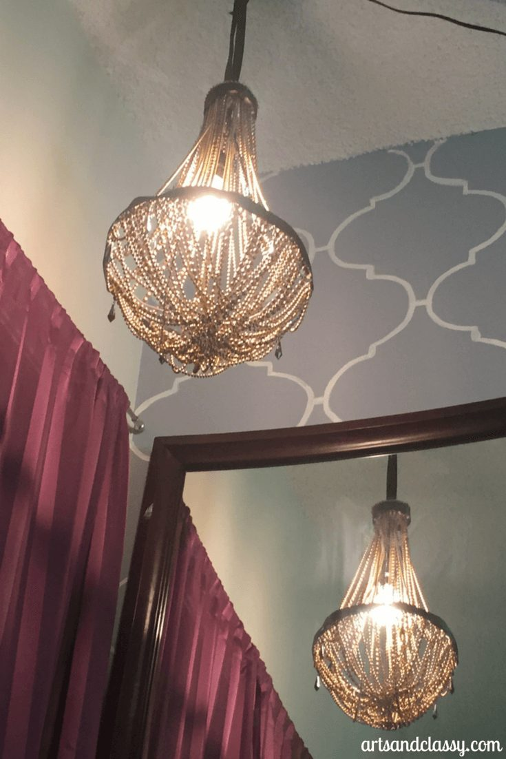 DIY vintage glam waterfall chandelier is apart of my bedroom makeover design on a dime  via www.artsandclassy.com