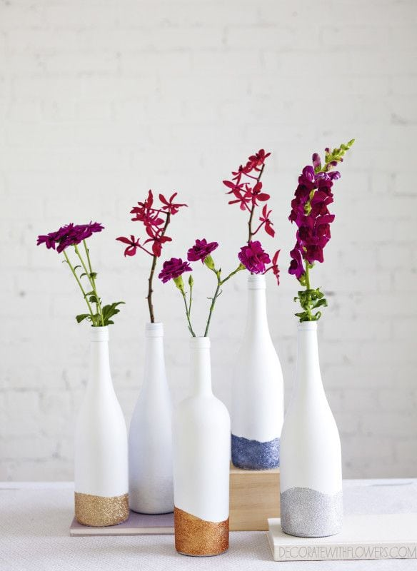 Decorate your room with flowers and this wine bottle craft.