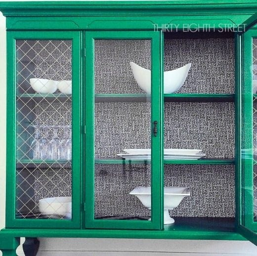 Painted hutch furniture flip with emerald green paint - Green is a hot home decor trend right now, so check out these gorgeous furniture flips. Furniture makeovers with all shades of green paint | Green painted furniture.