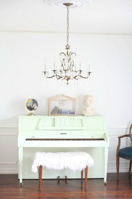 Pale green painted piano - Green is a hot home decor trend right now, so check out these gorgeous furniture flips. Furniture makeovers with all shades of green paint | Green painted furniture.