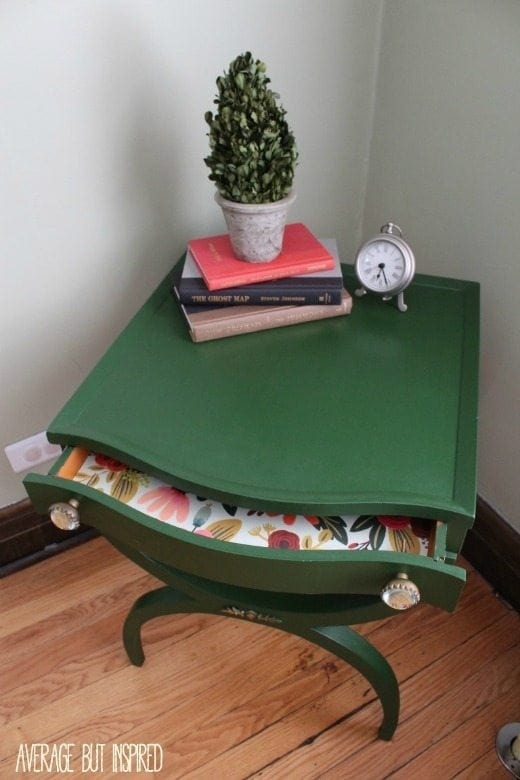 Thrifted green side table - Green is a hot home decor trend right now, so check out these gorgeous furniture flips. Furniture makeovers with all shades of green paint | Green painted furniture.