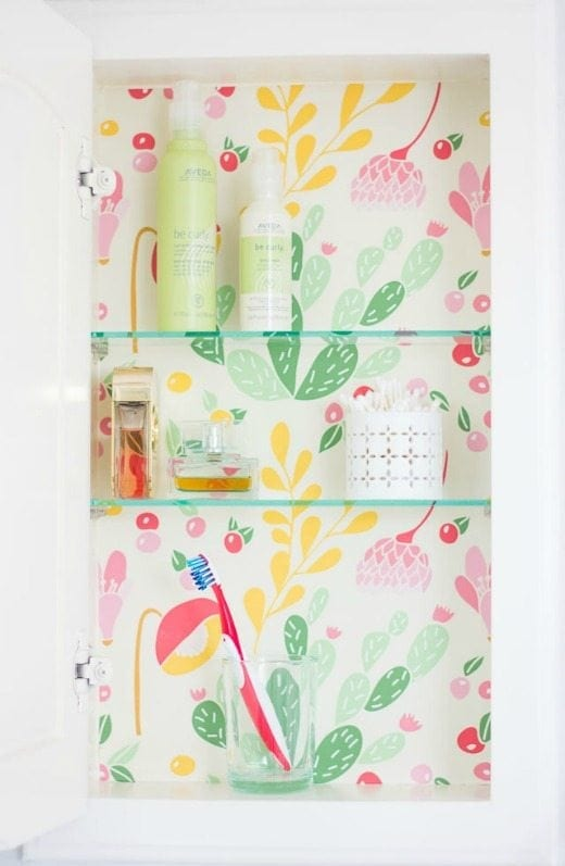 Wallpaper Medicine Cabinet - Decorating with wallpaper is so popular in home decor. Many peel-and-stick options are temporary, making this the perfect way for renters and homeowners alike to spruce up their space | Rental-friendly decorating with wallpaper.